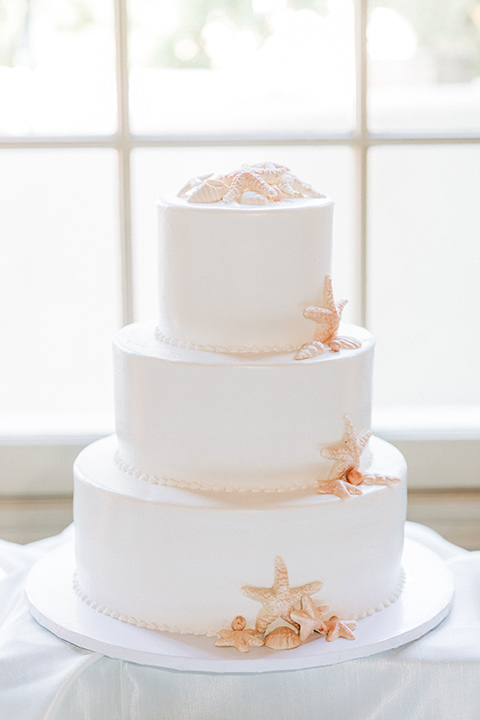 San-Diego-Beach-wedding-cake-with-white-fondant-and-seastar-shapes