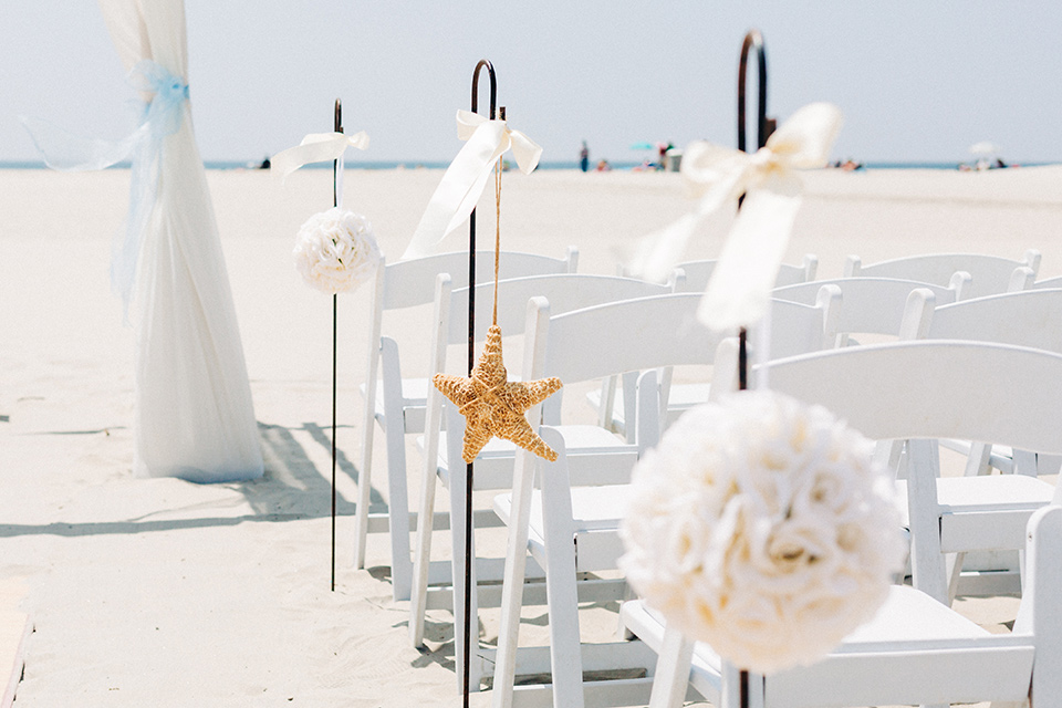 San-Diego-Beach-wedding-ceremony-chairs-in-white-with-nautical-decor
