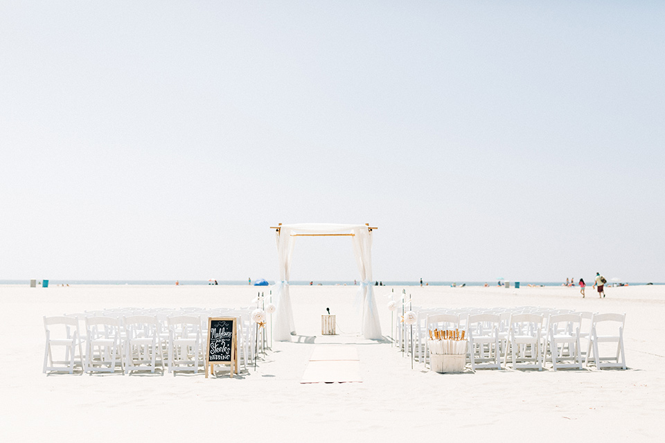 San-Diego-Beach-wedding-ceremony-set-up-with-white-décor-on-the-sand