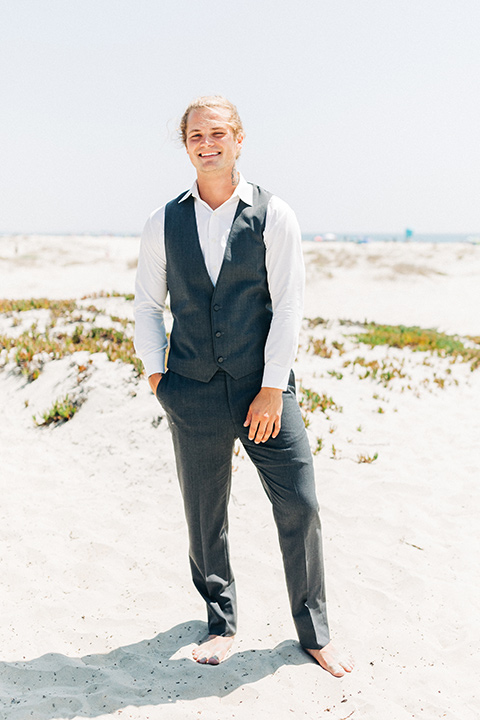 San-Diego-Beach-wedding-groom-in-a-grey-suit-pant-and-vest