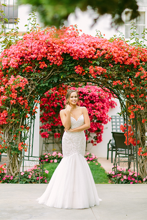 omni-la-costa-bride-alone-bride-wearing-a-lace-fitted-gown-with-mermaid-style-with-thin-straps