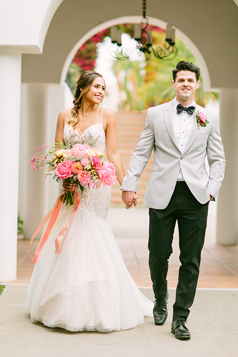 omni-la-costa-bride-and-groom-bride-wearing-a-lace-fitted-gown-with-mermaid-style-with-thin-straps-groom-with-light-grey-jacket-with-black-pants-black-polka-dot-bowtie