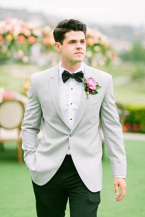 omni-la-costa-groom-standing-alone-groom-with-light-grey-jacket-with-black-pants-black-polka-dot-bowtie
