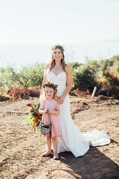Dos-pueblos-orchid-farm-wedding-bride-and-flower-girl-bride-in-a-fitted-boho-gown-flower-girl-in-pink-dress