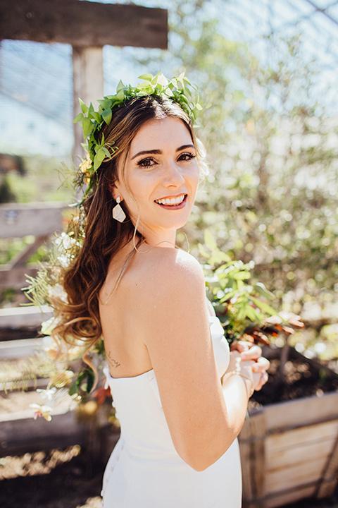 Dos-pueblos-orchid-farm-wedding-bride-looking-at-camera-bride-wearing-a-strapless-gown-wih-a-green-floral-headpiece