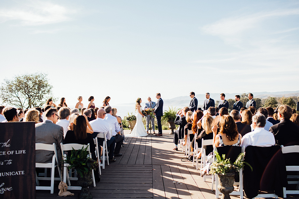 Dos-pueblos-orchid-farm-wedding-ceremony-bride-and-groom-holding-hands