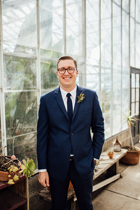 Dos-pueblos-orchid-farm-wedding-groom-smiling-at-camera-wearing-a-navy-suit