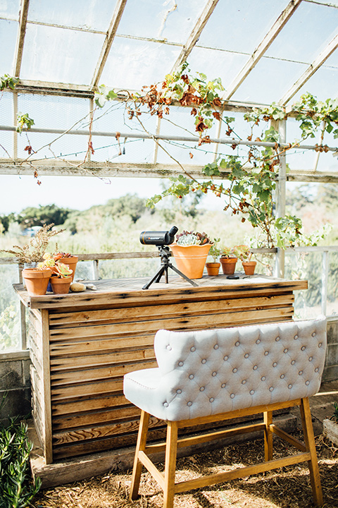 Dos-pueblos-orchid-farm-wedding-inside-glass-building-white-couches-and-bar