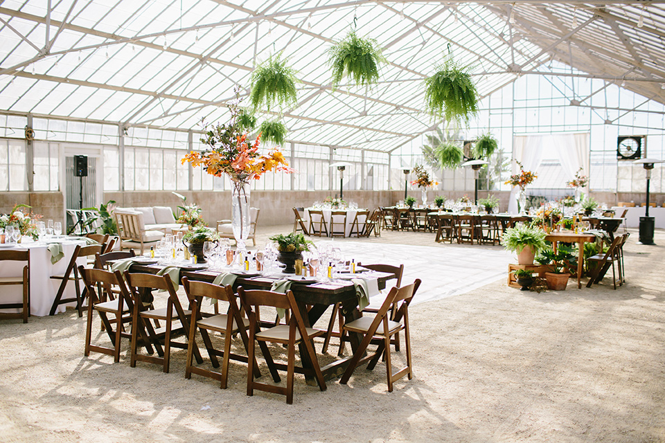 Dos-pueblos-orchid-farm-wedding-reception-with-wooden-tables-and-green-florals