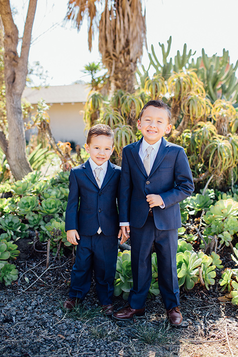 Dos-pueblos-orchid-farm-wedding-ring-barers-wearing-blue-suits-to-match-the-groomsmen