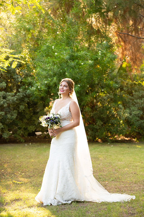 Palm-Springs-wedding-at-the-parker-bride-alone-in-a-flowing-gown-and-a-deep-v-neckline