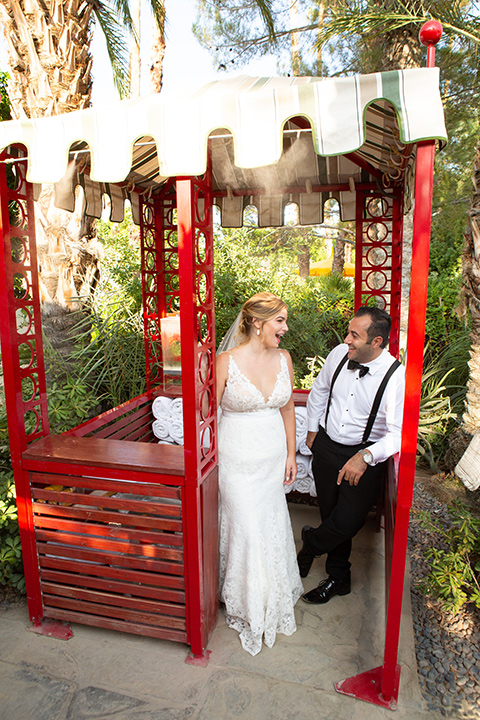 Palm-Springs-wedding-at-the-parker-bride-and-groom-in-fun-outdoor-decor-bride-alone-in-a-flowing-gown-and-a-deep-v-neckline