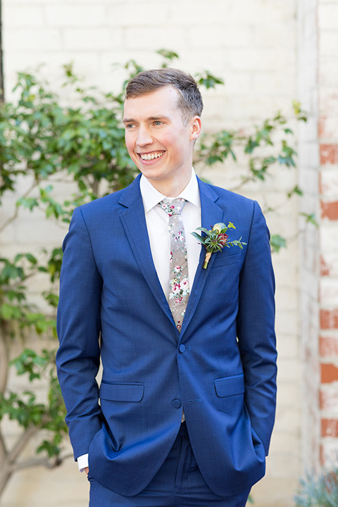 palos-verdes-shoot-groom-standing-hands-in-pockets-groom-wearing-a-colbalt-blue-suit-with-a-grey-floral-long-tie