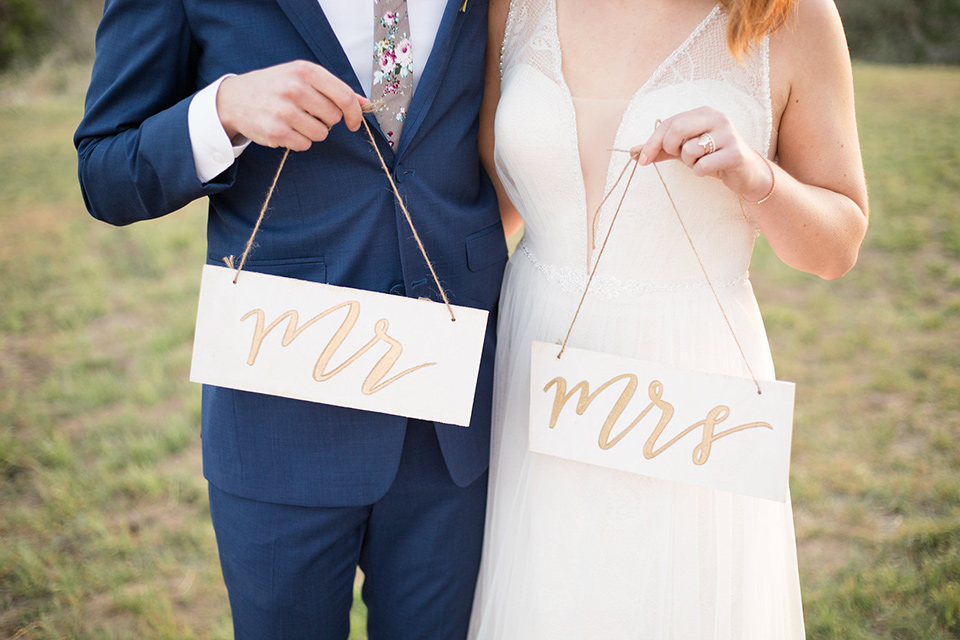 palos-verdes-shoot-mr-mrs-signs-bride-wearing-a-flowing-gown-with-straps-and-a-illusion-v-neck-groom-wearing-a-colbalt-blue-suit-with-a-grey-floral-long-tie
