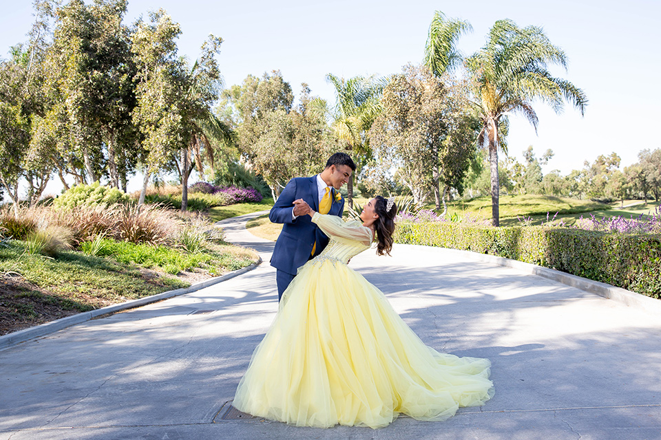 quince-shoot-birthday-girl-in-yellow-dress-chambelan-in-royal-blue-suit-in-a-beauty-and-the-beast-inspired-quince