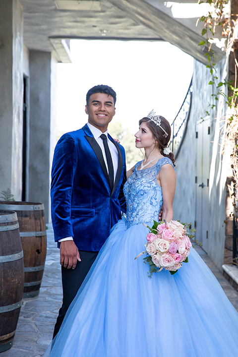 quince-shoot-birthday-girl-in-a-baby-blue-cinderella-dress-chambelan-in-a-royal-blue-vlevet-tuxedo-close-up