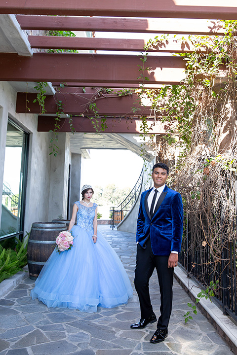 quince-shoot-birthday-girl-in-a-baby-blue-cinderella-dress-chambelan-in-a-royal-blue-vlevet-tuxedo-for-a-cinderella-inspired-quince