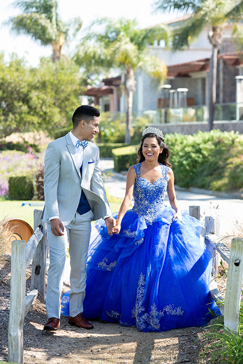 quince-shoot-blue-and-grey-color-scheme-with-girl-in-a-lue-gown-with-a-cap-sleeve-chambelan-in-a-grey-suit-with-blue-acessories