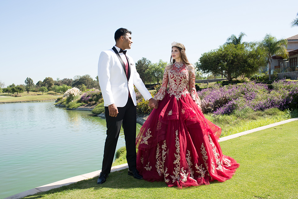 quince-shoot-burgundy-black-and-white-color-scheme-bithday-girl-wearing-a-burgundy-gown-with-sleeves-and-boy-wearing-a-white-tuxedo=with-black-trim-and-a-burgundy-vest