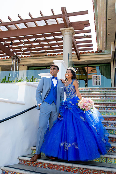 quince-shoot-shades-of-blue-color-scheme-birthday-girl-in-a-blue-gown-and-boy-in-a-blue-suit-with-blue-acessories