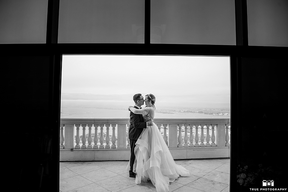 Hyatt-San-Diego-wedding-bride-and-groom-in-black-and-white-phooto-the-bride-is-in-a-blush-toned-ballgown-and-the-groom-in-a-black-shawl-lapel-tuxedo