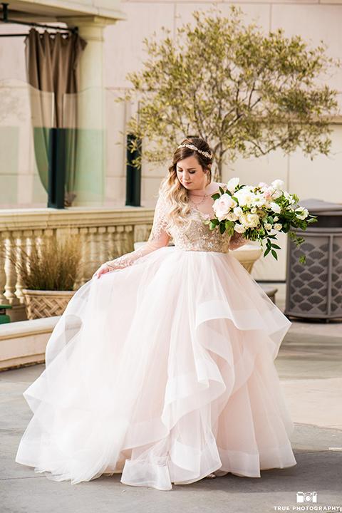 Hyatt-San-Diego-wedding-bride-looking-at-gown