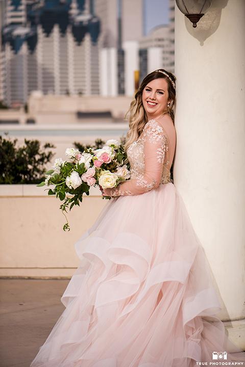 hyatt-san-diego-wedding-bride-looking-at-camera-in-a-blush-toned-ballgown
