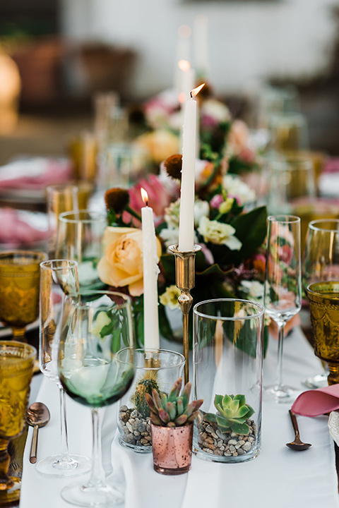 Olivas-Adobe-spanish-inspired-shoot-candles-with-white-linens-on-the-table-and-muted-color-glassware