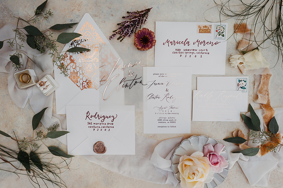 Olivas-Adobe-spanish-inspired-shoot-invitations-with-white-paper-and-rose-colored-cursive