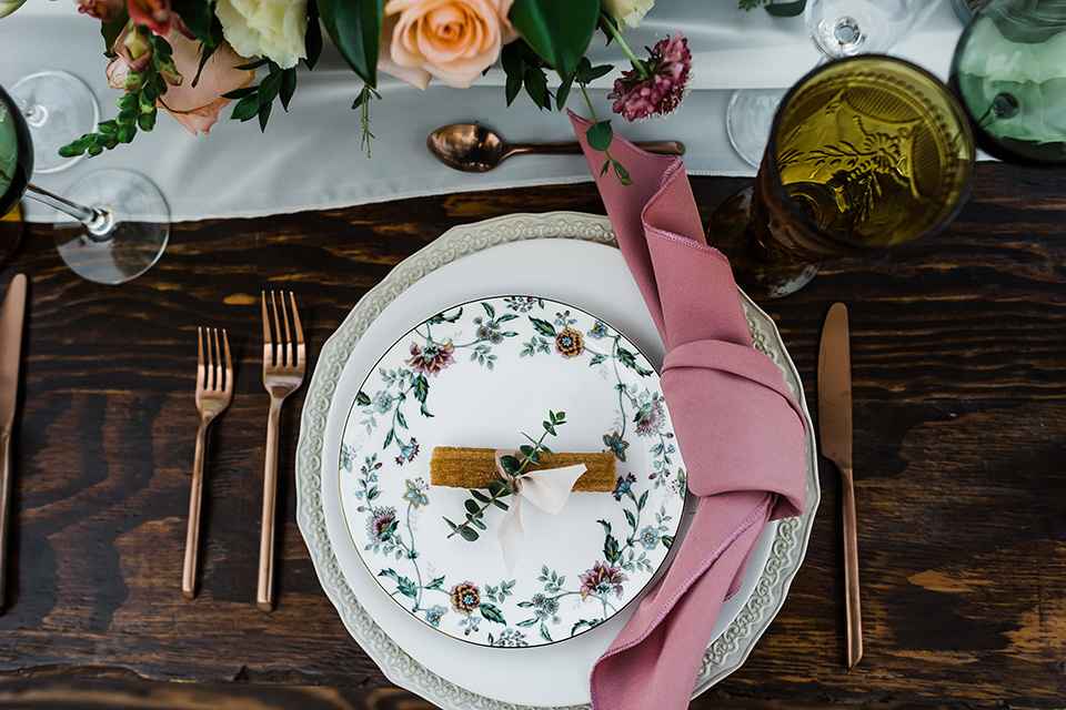Olivas-Adobe-spanish-inspired-shoot-table-placement-with-pink-napkins-and-white-table-linens-and-gold-silverware