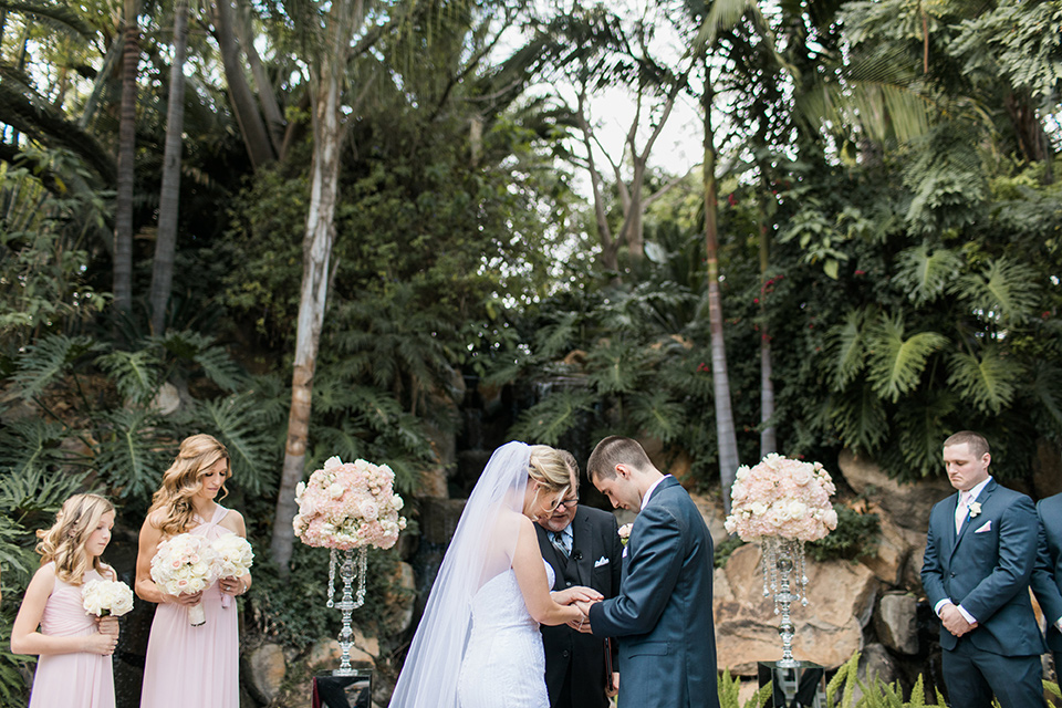 ceremony-bowing-heads-the-bridesmaids-in-pink-long-gowns-groomsmen-in-blue-suits-the-bride-was-in-a-trumpet-style-gown-with-a-strapless-neckline-and-the-groom-is-a-navy-suit-with-ivory-tie