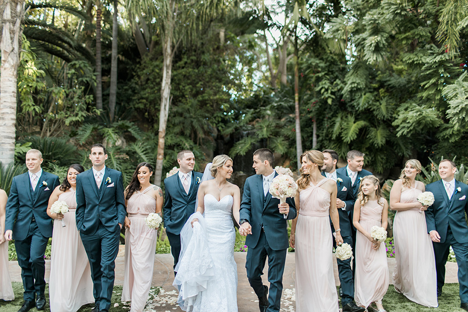 tropical-wedding-at-the-grand-tradition-bridalparty-the-bridesmaids-in-pink-long-gowns-groomsmen-in-blue-suits-the-bride-was-in-a-trumpet-style-gown-with-a-strapless-neckline-and-the-groom-is-a-navy-suit-with-ivory-tie