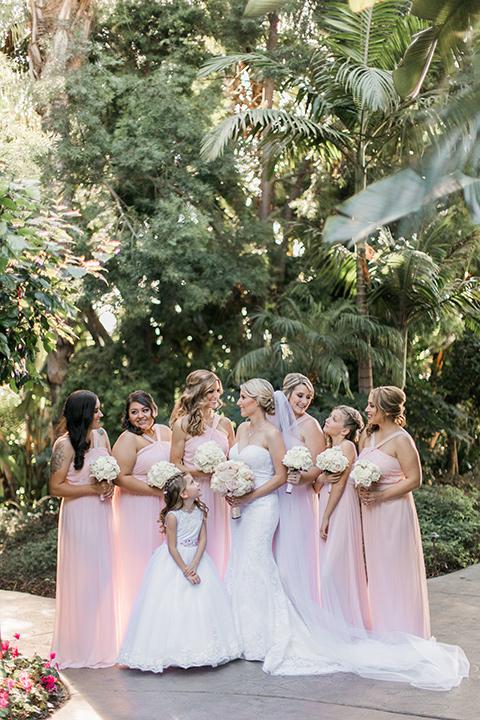 tropical-wedding-at-the-grand-tradition-bridesmaids-looking-at-camera
