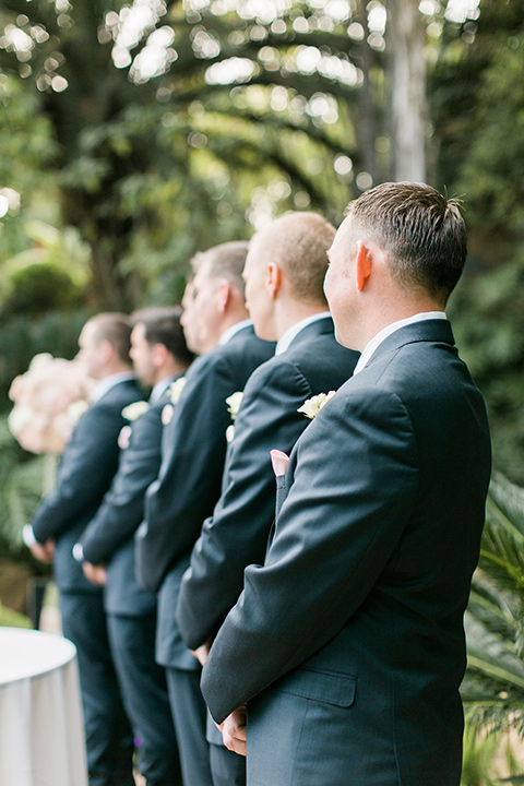 tropical-wedding-at-the-grand-tradition-groomsmen-at-ceremony-in-blue-suits