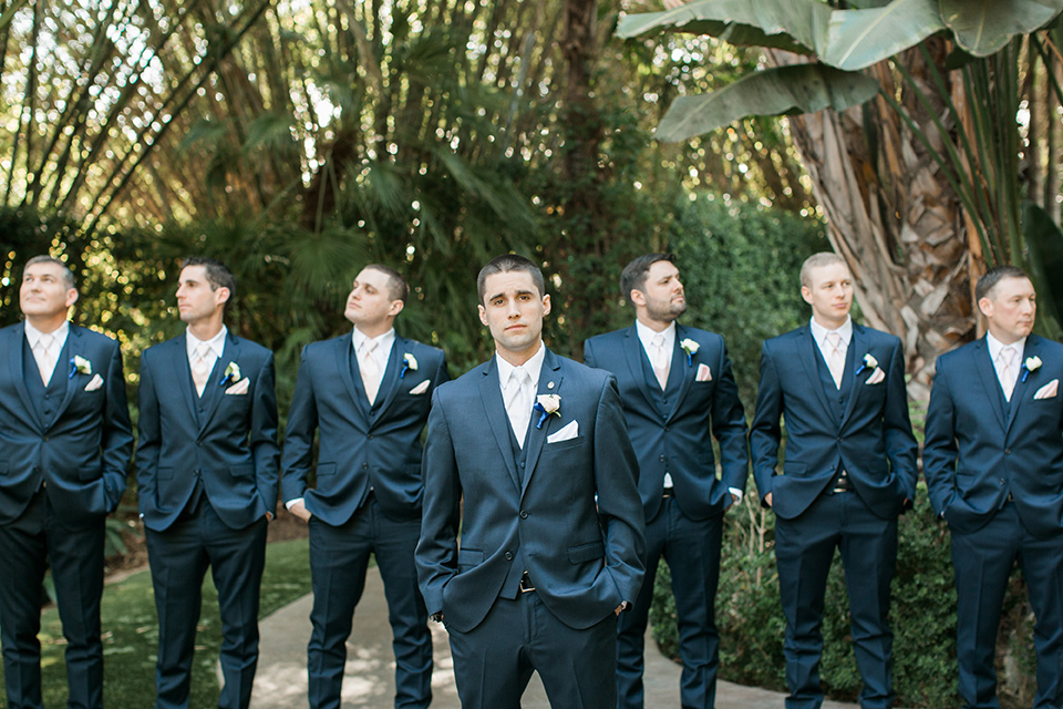 tropical-wedding-at-the-grand-tradition-groomsmen-facing-camera-in-navy-blue-suits