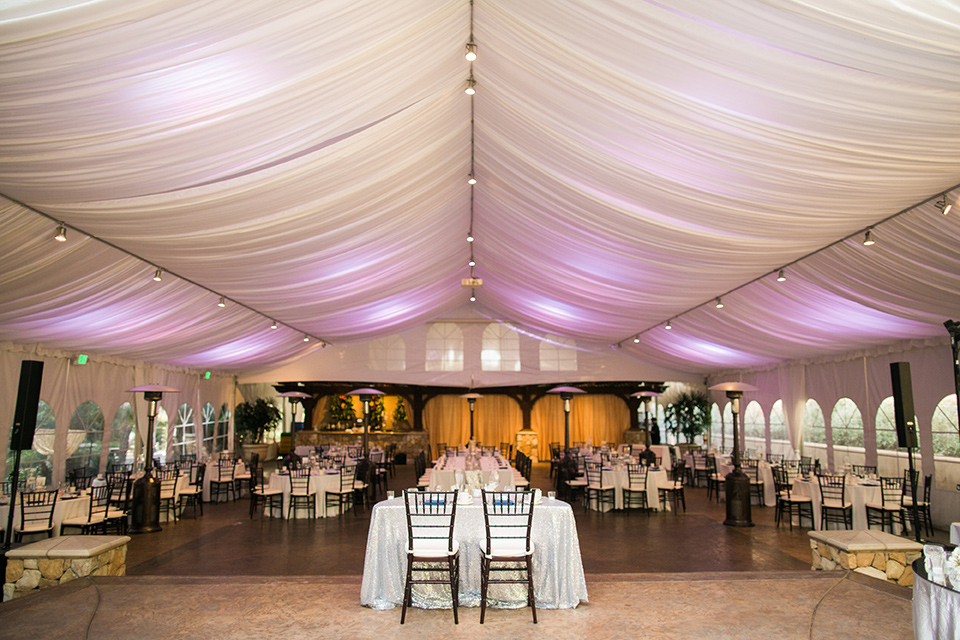 tropical-wedding-at-the-grand-tradition-reception-space-with-draping-white-linens-and-fun-purple-lights
