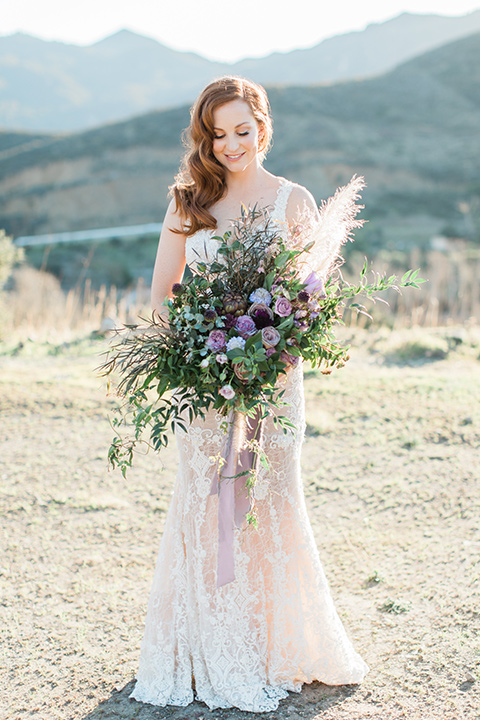 triunfo-creek-vineyards-wedding-bride-alone-wearing-a-flowing-ivory-and-blush-gown-with-straps-and-a-sweetheart-neckline
