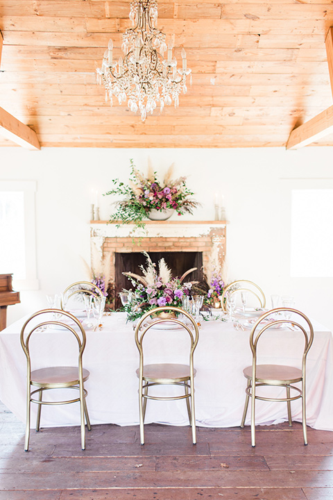 triunfo-creek-vineyards-wedding-table-and-chairs-with-white-linens-and-purple-and-gold-decor