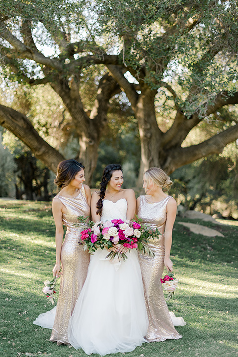 milagro-winery-bridesmaids-and-bride-bride-in-a-tulle-ball-gown-bridesmaids-in-gold-sequenced-form-fitting-dresses