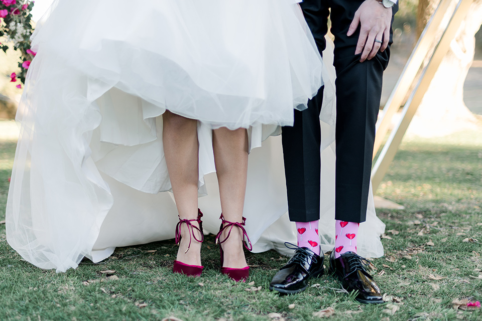 milagro-winery-close-up-on-socks-and-shoes-bride-in-a-tulle-ball-gown-groom-in-a-black-shawl-lapel-tuxedo