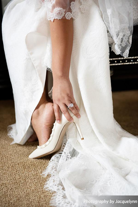 bride wearing white pointed toe shoes