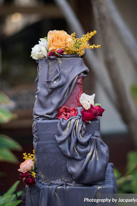 black cake with colorful flowers