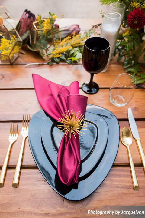 farmhouse tables with black flatware and gold utensils