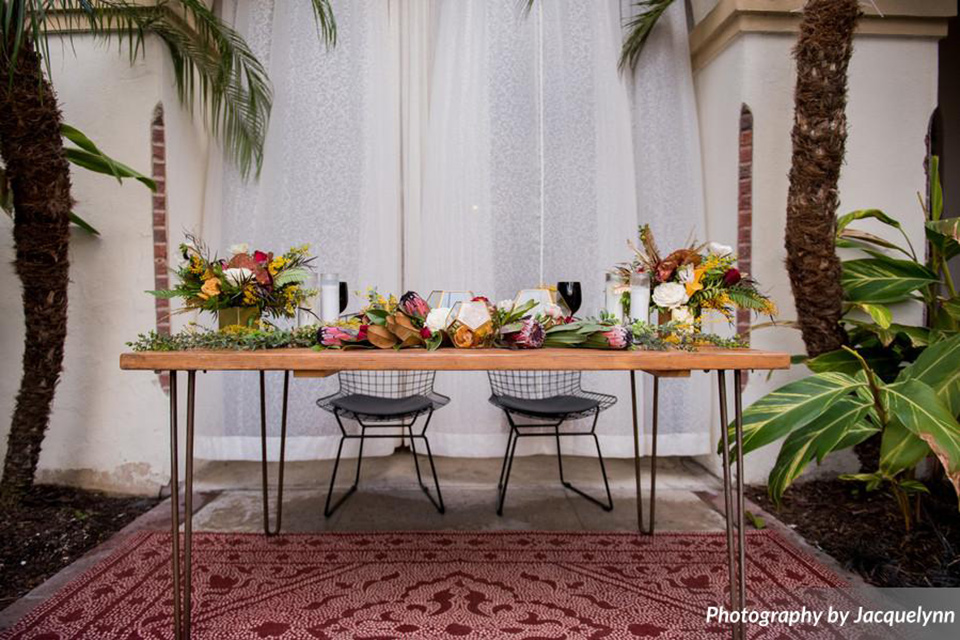 farmhouse table with colorful florals and tall candles