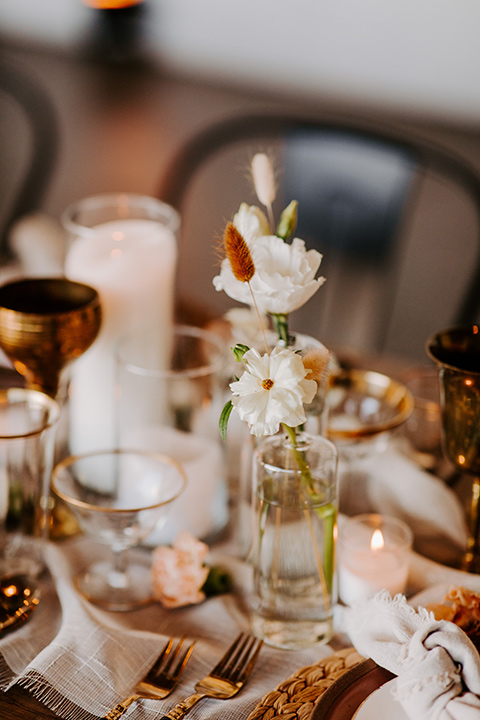 farmhouse bohemian style décor at reception sweetheart table with white and burnt orange decor