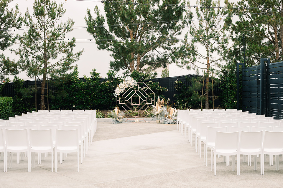 ceremony space with white chairs
