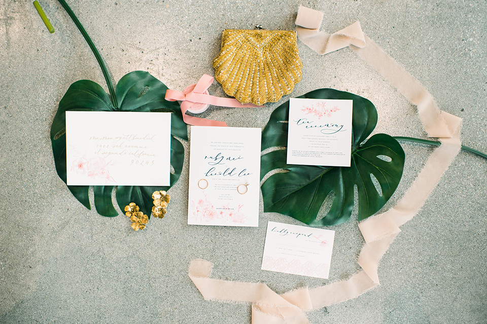 tropical inspired invitations with gold calligraphy