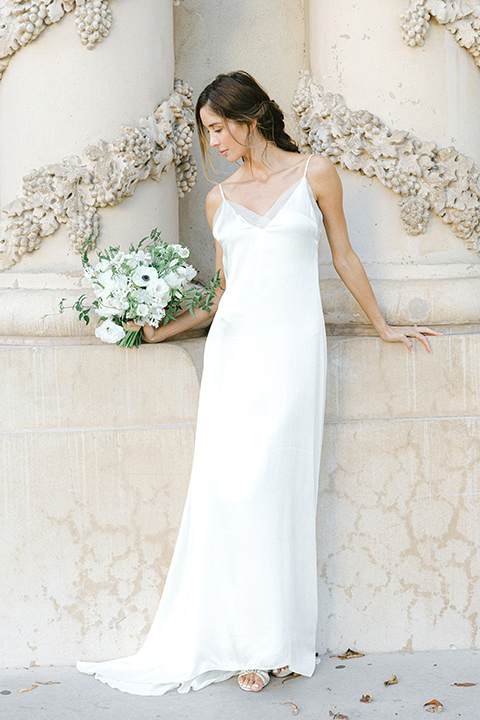 bride in a satin formfitting gown with thin straps
