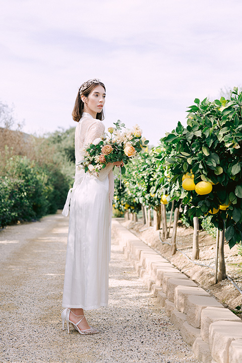 bride in vineyard with florals