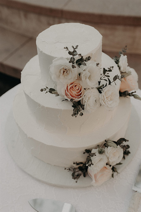 white cake with whte and pink floral design